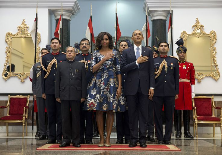 President Barack Obama, first lady Michelle Obama, and Indian President Pranab Mukherjee stand during the US National Anthem before a receiving line at the State Dinner at the Rashtrapati Bhavan, the presidential palace, in New Delhi on January 25. Obama's arrival Sunday morning in the bustling capital of New Delhi marked the first time an American leader has visited India twice during his presidency.