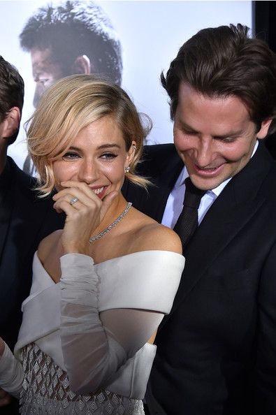 """Sienna Miller Photos Photos - Actors Sienna Miller (L) and Bradley Cooper arrive at the """"American Sniper"""" New York Premiere at Frederick P. Rose Hall, Jazz at Lincoln Center on December 15, 2014 in New York City. - 'American Sniper' Premieres in NYC — Part 2"""