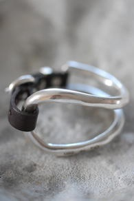 silver and leather cuff
