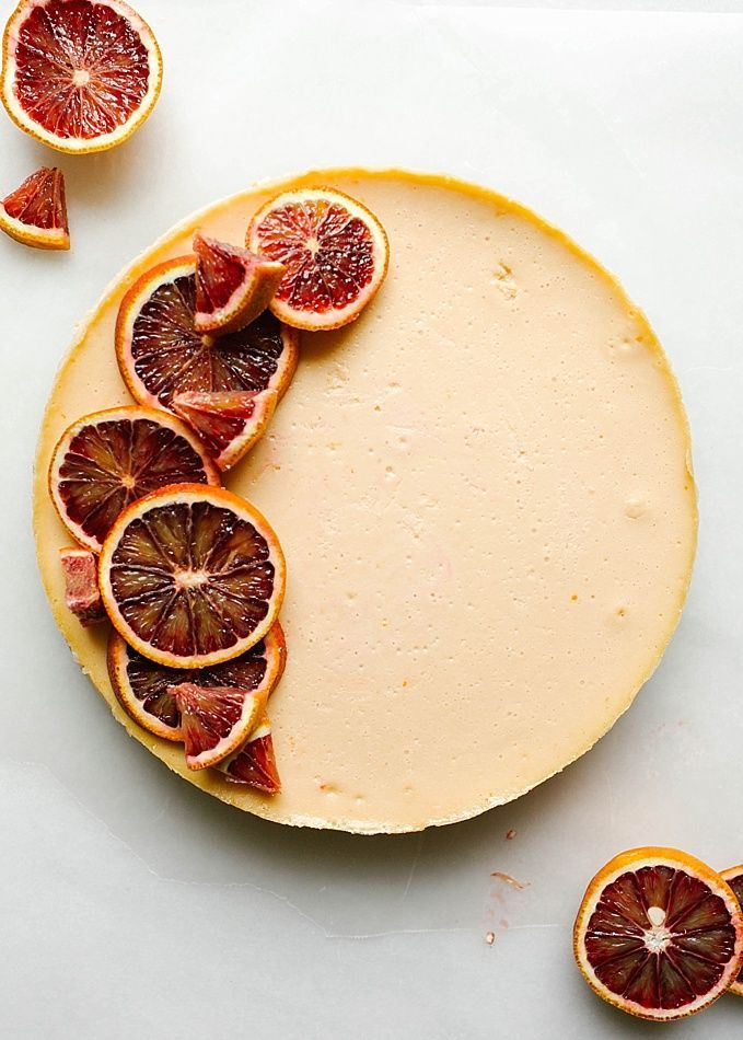 Blood Orange Cheesecake Recipe by The Wood and Spoon blog by Kate Wood. This recipe is for a citrus cheesecake flavored with ruby red blood oranges, The crust is a cinnamon brown sugar and graham cracker crust and the whole thing is topped with a sweet whipped cream topping. The cheesecake, made with cream cheese, is adapted from miette bakery, and has a beautiful pink orange hue due to the oranges! This recipe gives a lot of how-to's on making cheesecakes without crack, bubbles, soggy crust…