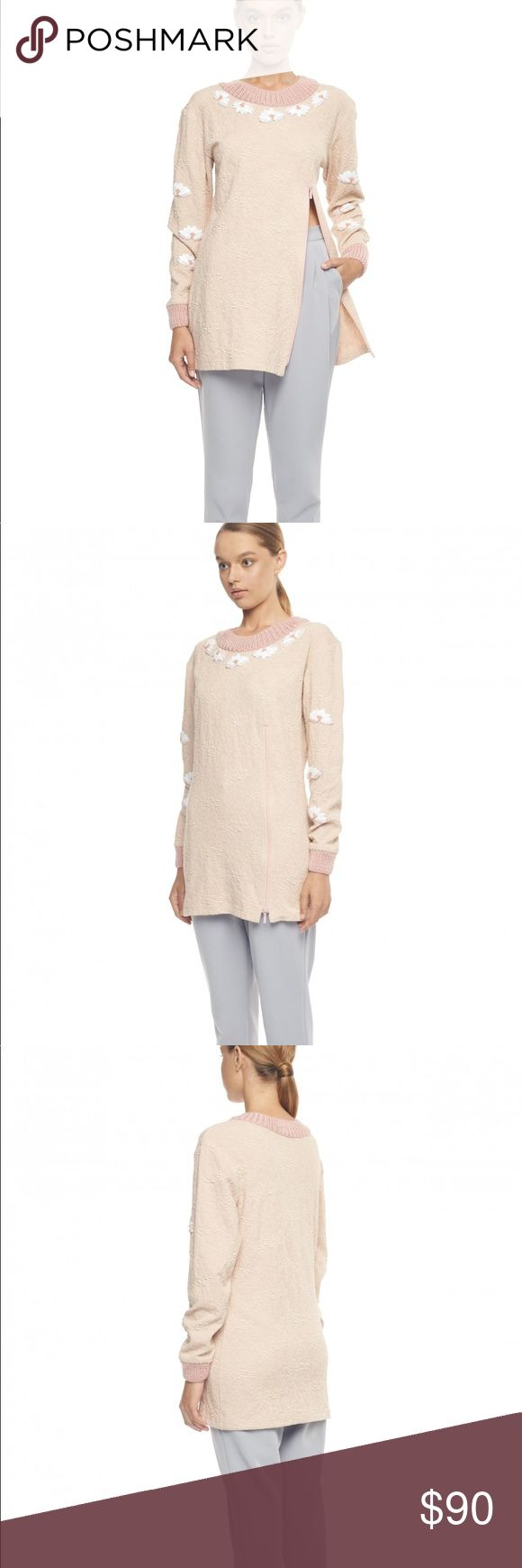 Pastel Pink Jersey Sweatshirt This pastel pink jersey sweatshirt featuring knit and floral details. Featuring a zip detail on the body, this piece allows you to unzip if it's a little warm, or to show off your favorite trousers. Paired with cropped trousers and nude heels, it's a fantastic feminine everyday sweatshirt. Tops Sweatshirts & Hoodies