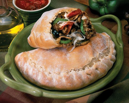 These folded over, pizza meal in your hand calzones are a real favorite for hectic lifestyle convenience.  Their hearty goodness warms any heart and stomach.