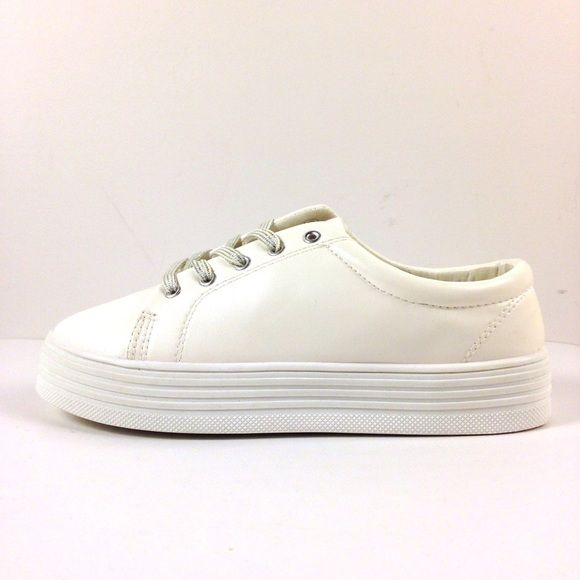 """20% OFF BUNDLESWHITE PLATFORM SNEAKERS / NIB New in box. Super cute white vegan leather platform / #flatform sneakers with silver laces. Marked size 8 but run 1/2 size small; best fit for a 7&1/2. Heel/platform:1"""". Price firm unless bundled. 20% OFF ALL BUNDLES Rouge Shoes Sneakers"""
