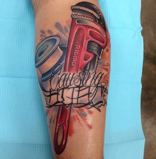 skull and pipe wrench tattoo