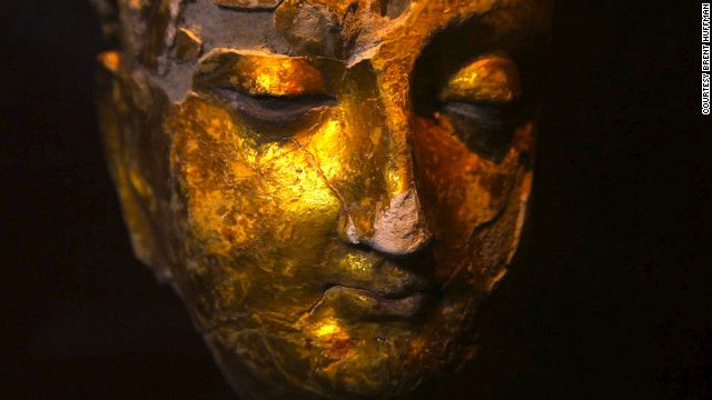 A gold-plated Buddha head found at Mes Aynak. A team of international archaeologists is scrambling to save relics.Mes Aynak is set for destruction at the end of December 2012. All of the temples, monasteries, statues as well as the Bronze age material will all be destroyed by a Chinese government-owned company called China Metallurgical Group Corporation (MCC). Six villages and the mountain range will also be destroyed to create a massive open-pit style copper mine.
