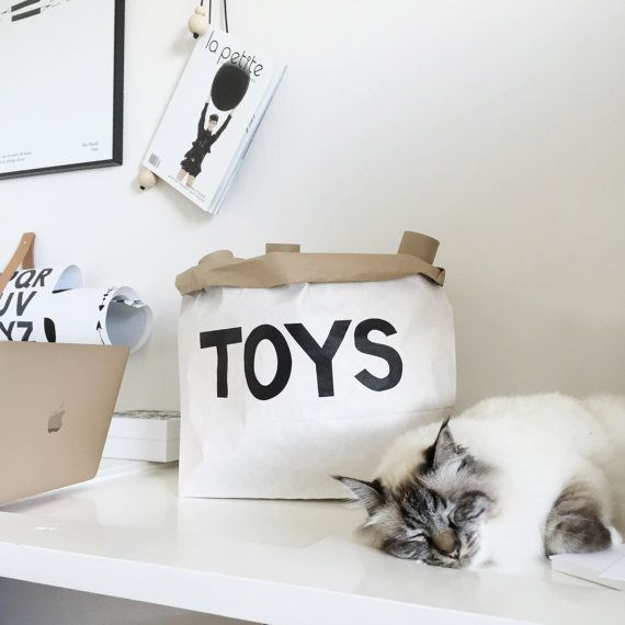 This gorgeous toy sack is made of paper, white and brown. Durable and reusable many times over. Once placed and arranged into shape, the paper bag becomes a design object in any kids room.  ☛Hand made ☚  Size: 55 x 22 x 40 cm
