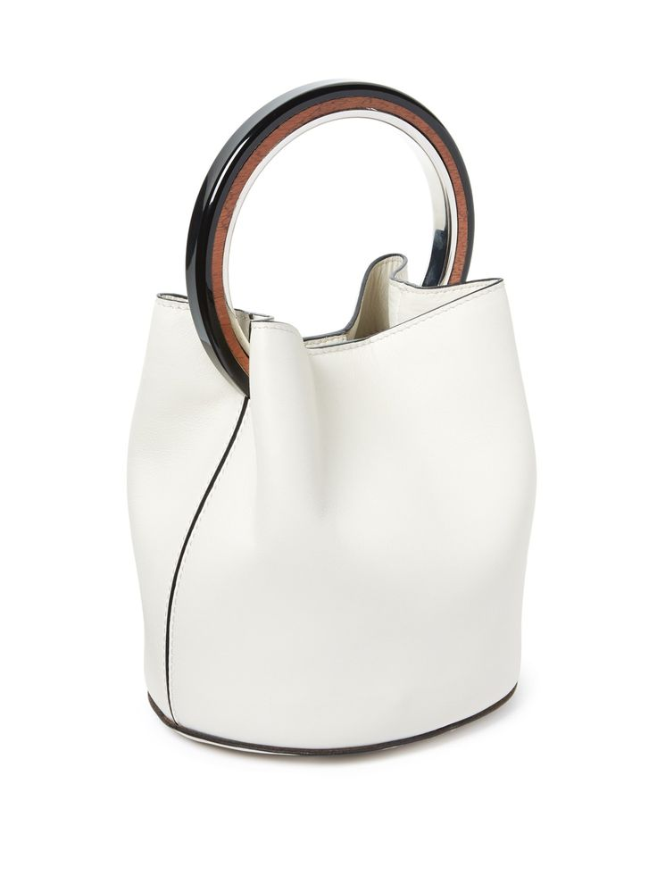 Marni's new-season collection is loaded with geometric details, and this white leather bag is a fresh illustration. It has an unlined shape that secures with a press-stud fastening, and can be carried through the city by the distinctive circular handle. Use it to give sophisticated looks a modern feel.