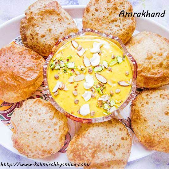 Amrakhand(Mango Shrikhand) is a Gudi-Padwa (Hindu New Year celebrated in Maharashtra) special dessert, and best enjoyed with Hot Pooris (deep fried Indian bread).