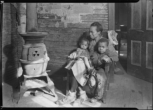 Scott's Run, West Virginia. Johnson family - father unemployed, March 1937  Original Caption: Scott's Run, West Virginia. Johnson family - father unemployed, March 1937   U.S. National Archives' Local Identifier: 69-RP-96   Photographer: Hine, Lewis