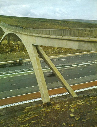 The Pennine Way overbridge near junction 22 M62. Originally this unusual structure was going to be a plain footbridge, but the story goes that the Transport Minister of the time was a keen walker and demanded a more impressive bridge to be built at considerable cost  photo by Terry Ogden