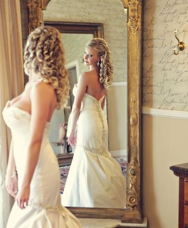 Alicia Clements from NaturallyCurly.com on her wedding day 2.  Curlformers were used to create her spiral wedding curls!