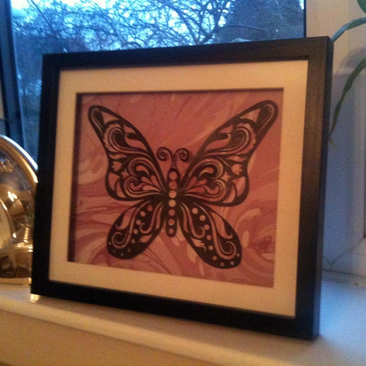 This decorative decorative butterfly papercut has been carefully hand cut from pearlescent black paper.
