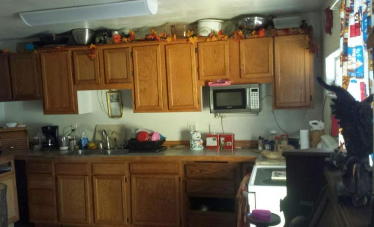 cluttered kitchen filled with everything stuff fake plastic vines leaves poor bad home staging Phoenix Arizona house for sale photo
