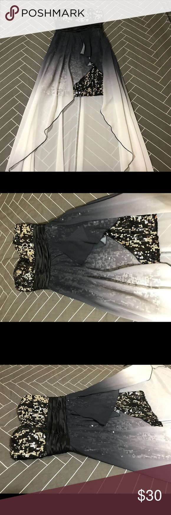 """Black and White Ombré High-Low Prom Dress Stunning strapless dress for prom or homecoming! The train has an ombré from black to white. I wore it once for senior prom with the black heels also in my closet!   Inside dress - 25.5"""" From top of dress to bottom of train - 46"""" Speechless Dresses Prom #blackhighheelsforhomecoming #promheelswhite #blackhighheelsforprom"""