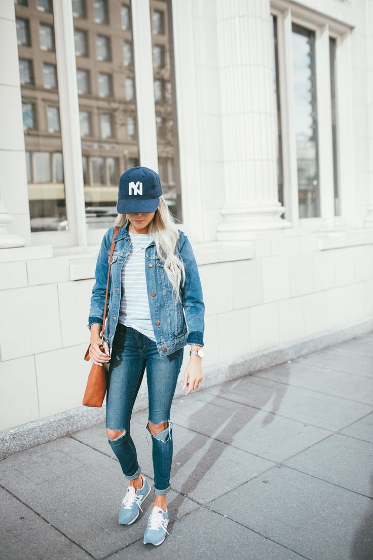 Cute casual weekend outfit - Yankee hat, light blue striped top, jean jacket, ripped skinny jeans and chambray blue New Balance sneakers