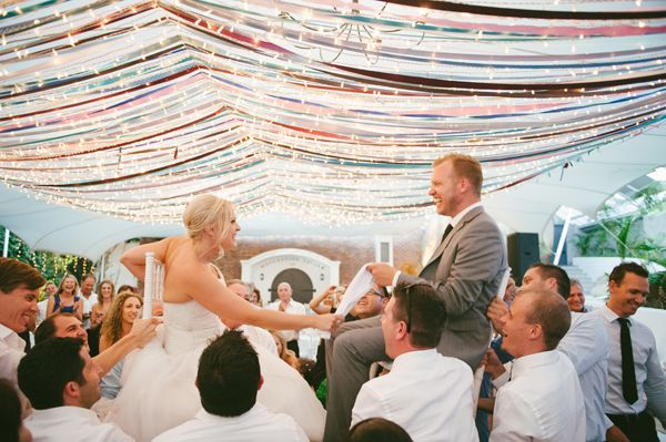 Waterside South African Wedding.  Love the lights and ribbon treatments.  So pretty!