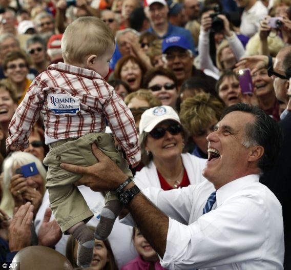 Republican presidential candidate and former Massachusetts Gov. Mitt Romney picks up a baby as he campaigns at The Golden Lamb restaurant in Lebanon, Ohio, Saturday, Oct. 13, 2012.