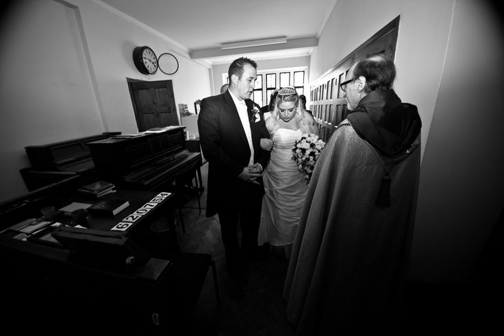 Signing the registrar. Traditional church wedding photography with the bride & groom at St Martin's Church Hale Gardens, Acton London
