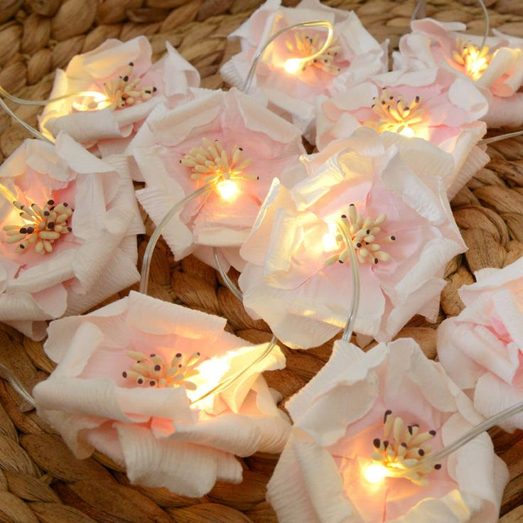 Soft Rose fairy lights.A gorgeous house warming gift or birthday present for a friend or relative. Battery operated with energy saving LED lights. Perfect table decorations where there is no power supply. Lovely for a wedding, for the top table, the cake, a Christening or party. Also for bedrooms around a mirror, window or picture. Length 2.9 metres which 1.9 metres are illuminated. 20 delicate rose petal lights. 3 AA batteries required, not included. Indoor use only!Paper.2.9 metres, 1.9…
