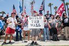 The Americans for Trump group gathered at the Huntington Beach Pier early Saturday afternoon to rally around President Donald Trump.