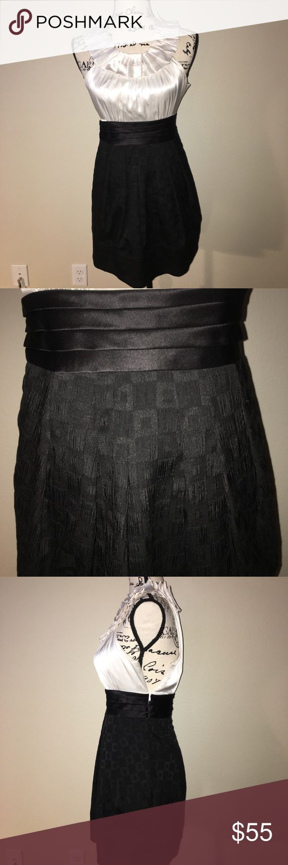 Bcbg black and white cocktail dress 2P Great condition bcbg black and white cocktail dress in size 2P. White satin and detailed collar at the top with black at the bottom. Two small marks on the back of the collar but they are hardly noticeable. Has pockets and side zipper. BCBGMaxAzria Dresses Mini