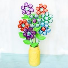 A cheerful bouquet made of Dove chocolates–best of both worlds for Mother's Day or a Teacher Appreciation gift! - See more at: http://www.isharefunfood.com/chocolate-mothers-day-flowers/#sthash.ixvJHEQk.dpuf