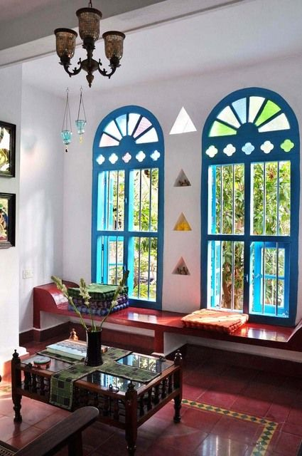 apartment with traditional south indian style .. love the style of the windows, the trim and color on them