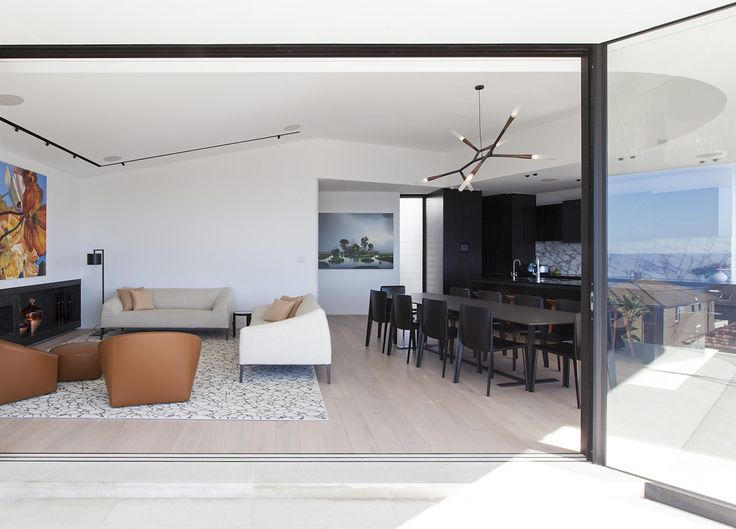 Love the track & suspended lighting in this space: Tamarama House   Porebski Architects   est living