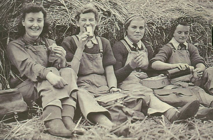 Four Land Girls on a lunch break. The women were were billeted at the Land Army Hostel in Wye.