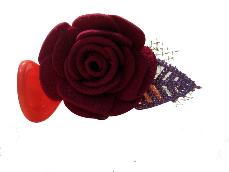 Red color flower banana pins (one flower), made of imported  rubber sheets, designed and crafted by village women, giving a   new fashion style to hair accessories.   Color: Red   Material: Imported Rubber sheets   Base material: Imported plastic Banana pin
