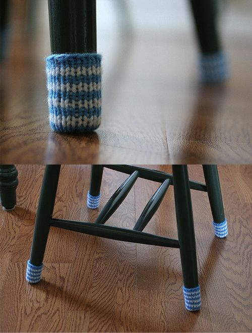Knit covers for chair legs. No more of those stupid little foam circles that are always falling off.