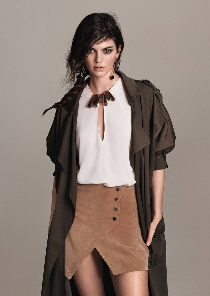 Kendall Jenner in a Mango suede skirt, blouse, and duster coat