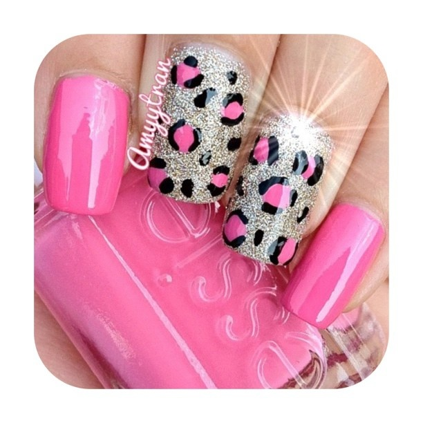 Bright pink nails with silver glitter and pink leopard accent nails free hand nail art