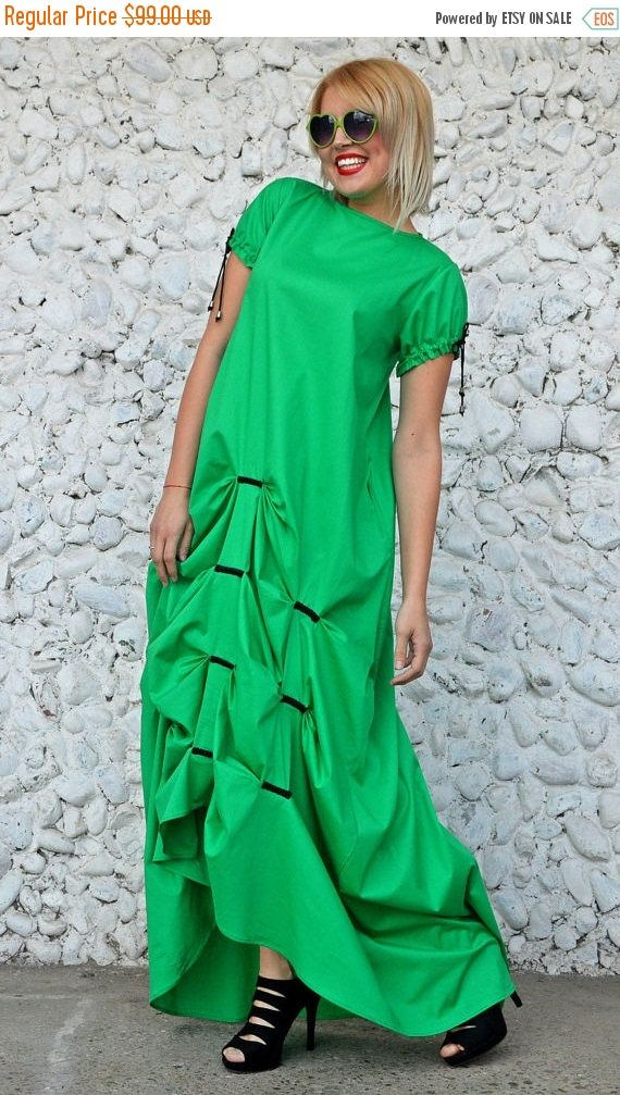 Extravagant green dress, long and flared, made of pure cotton, very soft and fun to wear. Such a comfortable piece that is both outstanding and easy to wear. You will for sure conquer the urban scene with this extravagant design! Material: 95% cotton, 5% elastane Care instructions: Wash at 30 degrees  The model in the picture is size S.  Can be made in ALL SIZES.  If you have any other specific requirements, do not hesitate to contact me!  I DO NOT CHARGE EXTRA MONEY for custom made items…