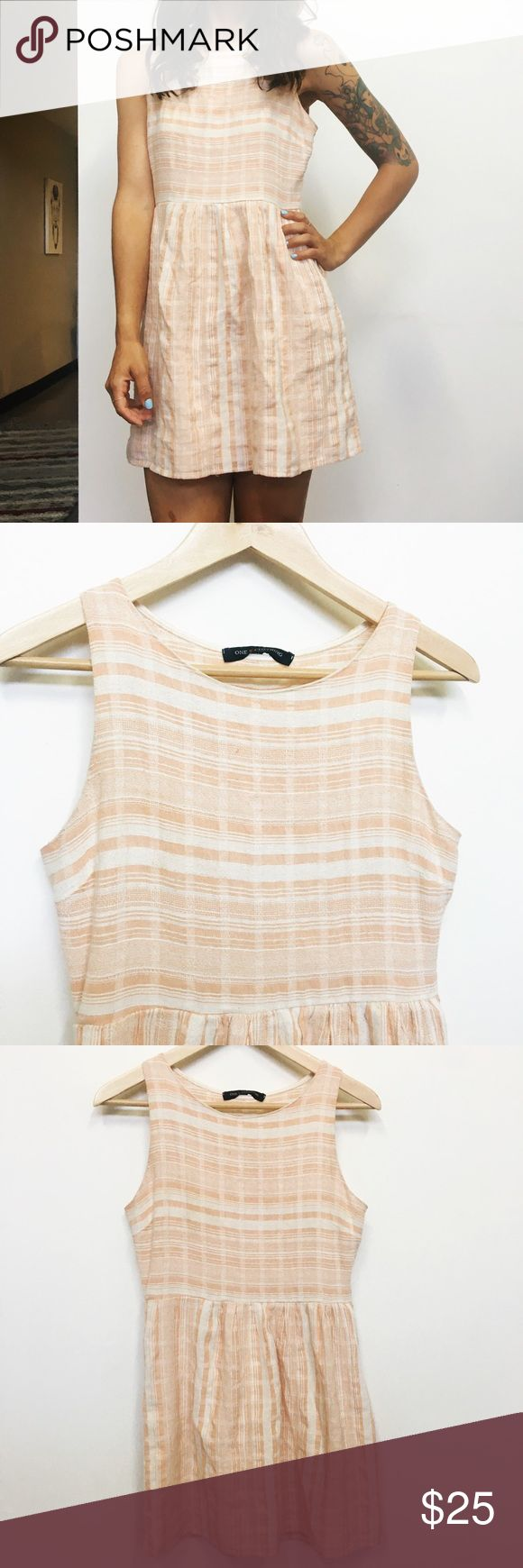 Tan and cream striped dress! This tan and cream striped dress is perfect for a picnic date! It's super comfy and look great with either sandals or flats. Second to the last photo shows one pulled thread, not very noticeable while wearing. one clothing Dresses