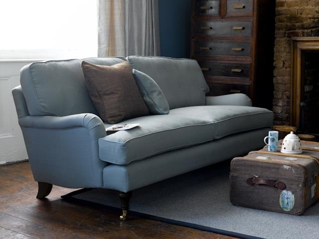Nice colour scheme in soft blues & browns & neutrals.Good use for vintage trunk as coffee table Sofa by sofa.com