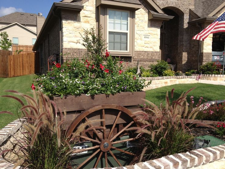 Wagon to hide large electric box in our yard handmade for Landscape rock utility cover