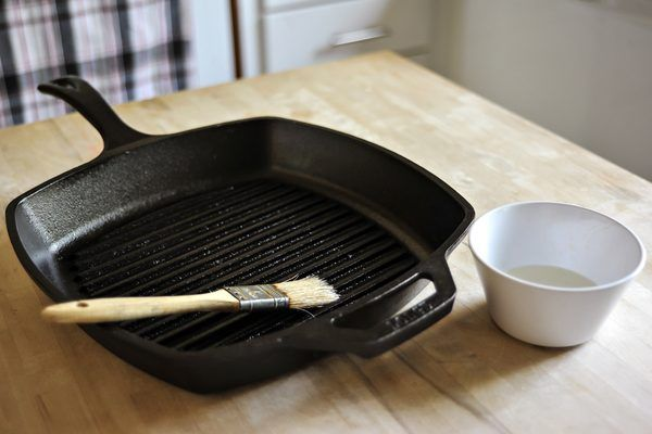 A well-seasoned cast iron skillet is naturally nonstick. A layer of oil bonds to the iron surface of the skillet, seasons the skillet and prevents food from sticking. Lodge Cast Iron skillets are pre-seasoned when purchased. You maintain the seasoning by proper use and cleaning. An old Lodge Cast Iron skillet may need to be reseasoned whenever it...