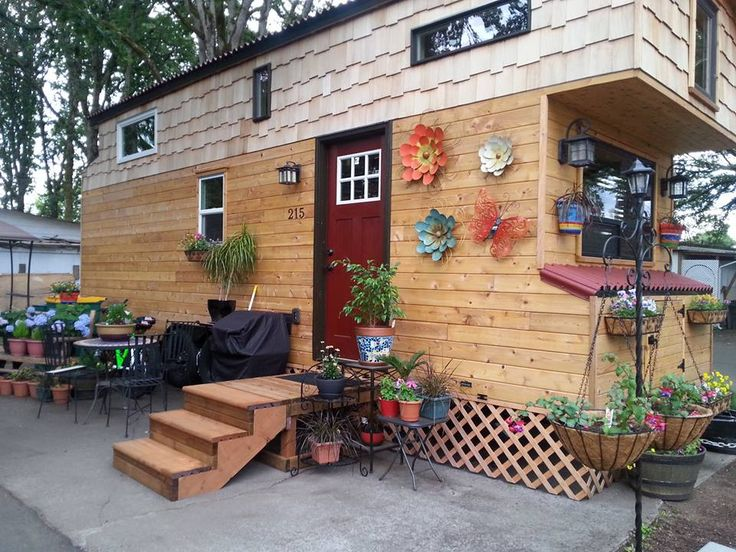 This is one couple's$20k DIY Tiny Homeon Wheels. It features a side entry and when you step inside, you'll find a living area, full kitchen, bathroom, lots of storage, and a spacious …