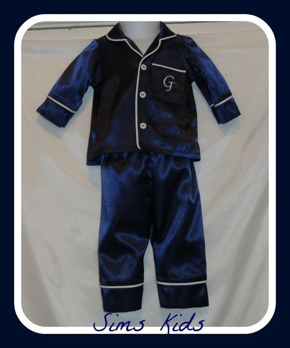 This a Satin girl or boy pajamas set . Top button down the front with a pocket and monogram pants has elastic in waist.  Great for a gift.  Come in 16 Color Black, Lime Green, Turquoise, Royal Blue, Yellow, , Kelly, Red, Purple, Gold, Pink, Navy Blue, Wine, Mist Aqua , Hot Pink, Orange. Come in baby size Newborn 3M 6M 9M 12M 18M.  Boy or Girl pajamas size: 2T 3T 4T 5T 6 7 8 9 10 12 14 16  TUNE AROUND TIME 2 WEEKS . IF YOU NEED IT BEFORE THEN PLEASE CONV ME.