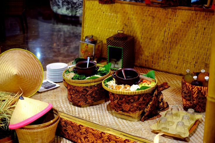 Pecel ( steamed vegie with peanut sauce) and rojak ( fruits and peanut sauce with brown sugar) stall, decorate with traditional batik sarong. #love #indonesia