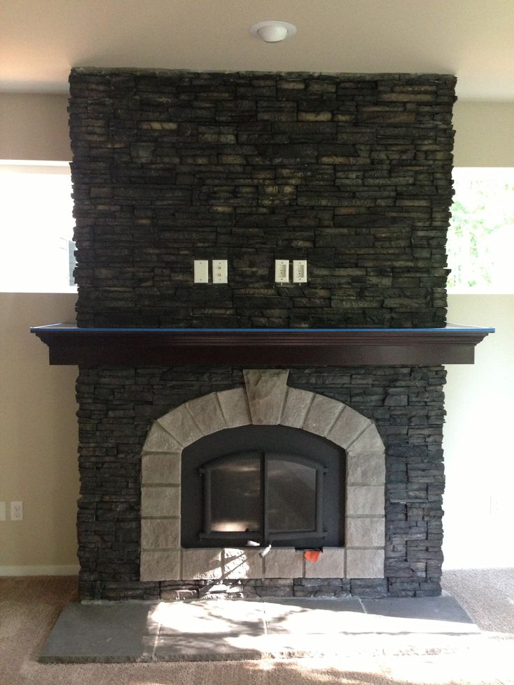 El Dorado stone Stacked StoneBlack River with SmokeChiseled Edge hearth  Stone used on homes