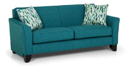 Don't be afraid to amp up your room's personality with a saturated color on your sofa - it's an easy way to add impact without clutter (Sunset Home 118 Sofa in Notion Hynotic.)