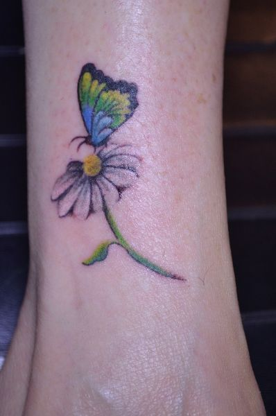 Butterfly and daisy tattoo idea #butterfly #tattoos