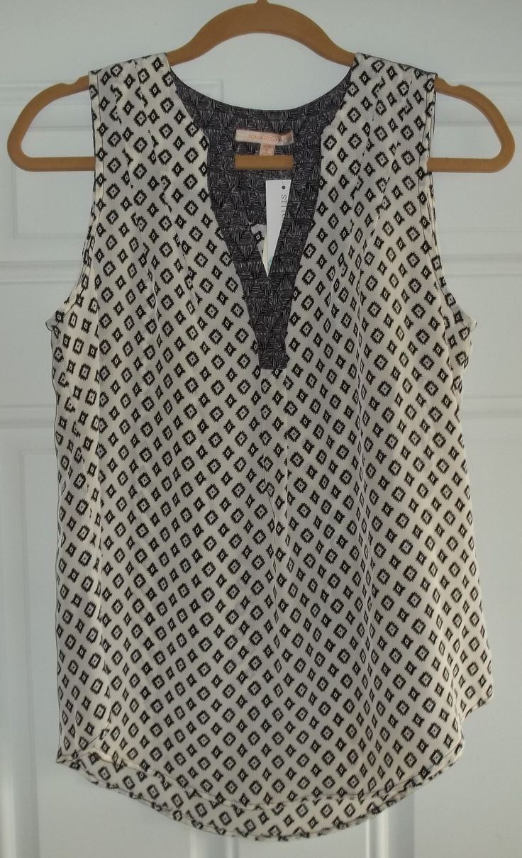 Something like this... That I could wear w black shorts, tights and cardigan now and just shorts and strappy heels in spring/summer! June 2015 Stitch Fix. Skies are Blue Pacheco Ikat V-Neck Top. Nice print with pretty back detail, soft, comfortable and very lightweight https://www.stitchfix.com/referral/4292370