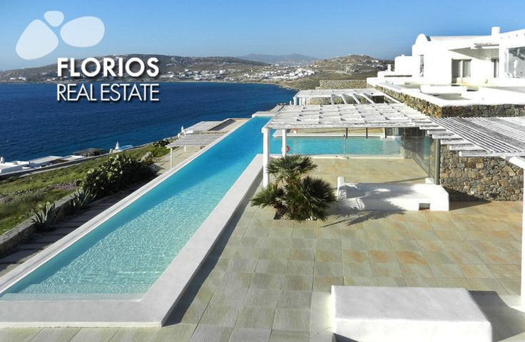 This Villa has an infinity pool with an extensive 30 meter length overlooking the Aegean Sea. Its unique T-shape connects flawlessly with the villa's indoor Jacuzzi (heated fresh water), although separated by a large glass panel. FL1214 Luxurious Villa for Sale on Mykonos island Greece. http://www.florios.gr/en/Villas-For-Sale-Mykonos-Island-Greece.html