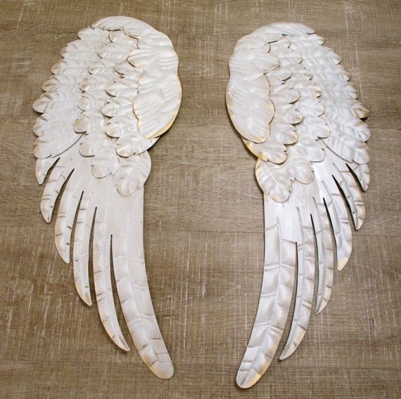 Designed & Crafted by me! These ethereal wings symbolize love ~ support ~ comfort & protection. Perfect for any room in the house. The wings Measure approximately 9 wide x 24 each. When hung side by side they measure approx. 20 x 24, leaving a gap between. THESE ARE FOR SALE RIGHT NOW......or you can custom order a color of your choice!  The details ~ The wings are lightweight metal & were hand painted using a lamp white coloring. They were then glazed with coffee stain. Next they were…