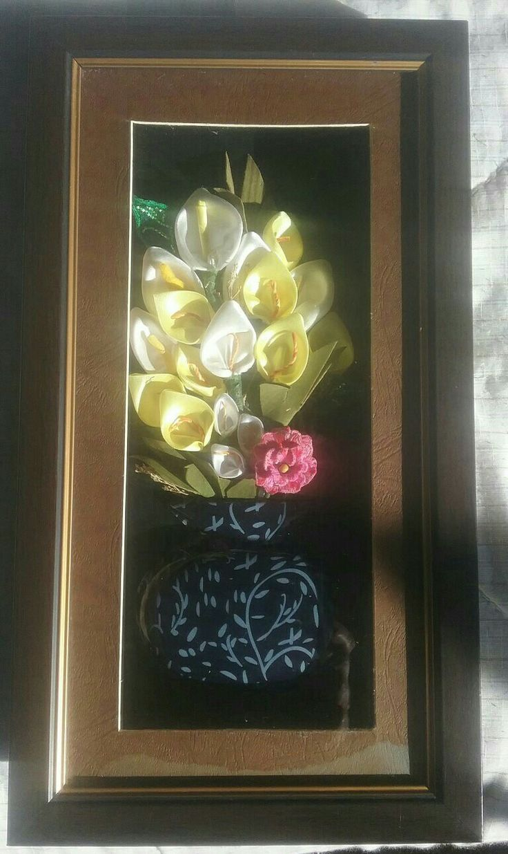 Ribbon work flowers with one stumpwork rose. I made this piece for my mother.
