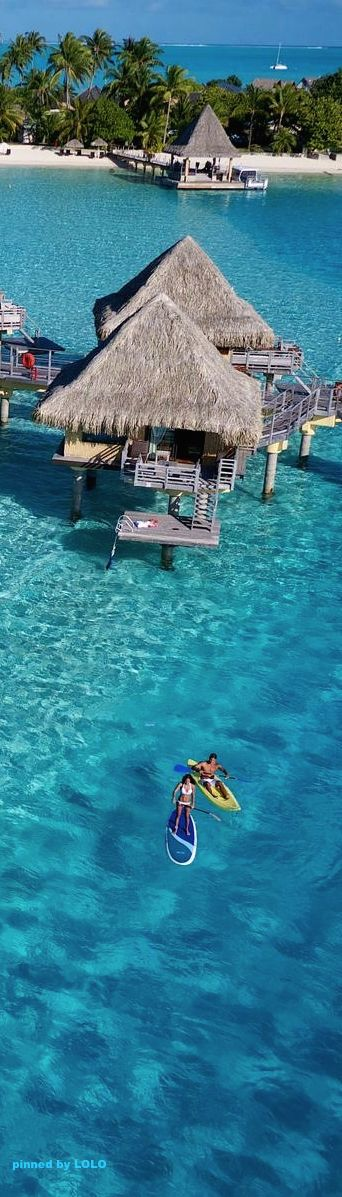 Bora Bora Resorts on the water, that clear clear water. The sun, the sand, everything.