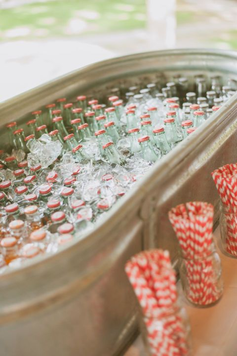 Hosting a barbecue, graduation party, or wedding this summer? Create an inexpensive cooler with a water trough that will keep drinks chilled all day. See more from Day 7 Photography at Style Me Pretty.